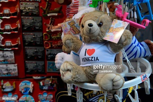 A picture taken on October 20 2017 shows a teddy bear with an inscription 'I love Venezia' A referendum will be held on October 22 2017 in the...