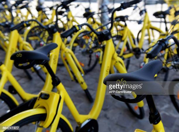 A picture taken on October 20 2017 shows Chinese stationfree bikes sharing platform OFO Bicycles at the 'Autonomy and the urban mobility' fair in...