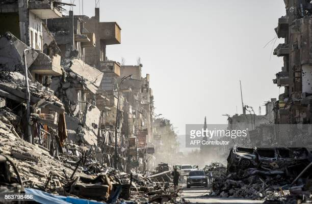 TOPSHOT A picture taken on October 20 shows a general view of heavily damaged buildings in Raqa after a Kurdishled force expelled Islamic State group...