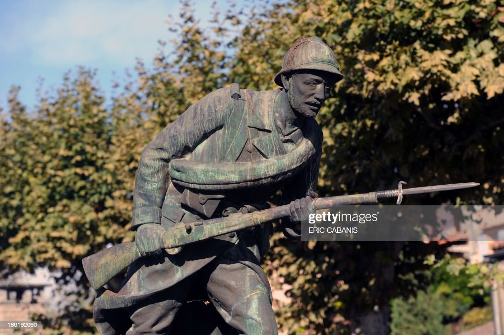A picture taken on October 21, 2013 shows a sculpture representing a 'Poilu', a French World War I soldier, at a WWI memorial in Verdun-sur-Garonne, southern France. 2014 will mark the 100th anniversary of the First World War, of which the commemorations will be the first without any direct witnesses of the conflict, as they all passed away.