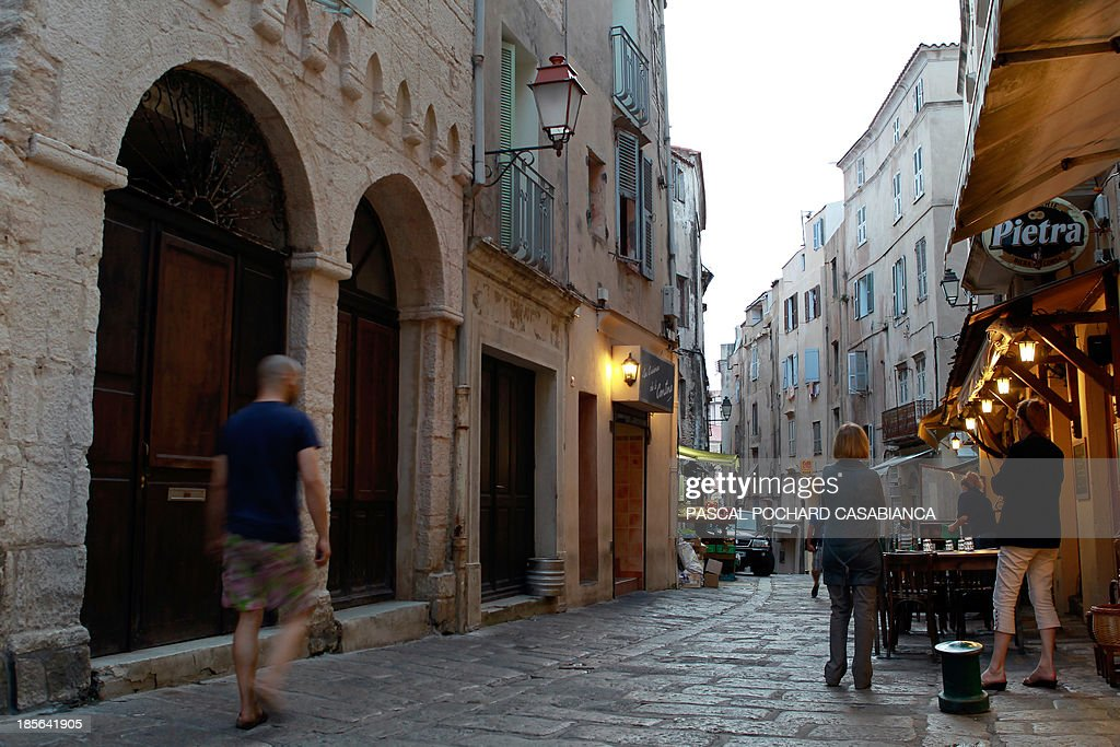 A picture taken on October 22, 2013 shows people walking in a street of the old city of Bonifacio, France's southern Mediterranean island of Corsica. Bonifacio is classified as one of France's most beautiful villages.