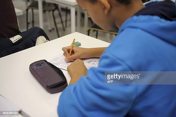 Picture taken on October 23 2013 shows a pupil working at Kuolsaari comprehensive school in Helsinki Asian nations cemented their top positions in an...