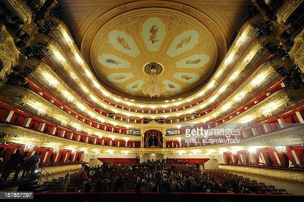 A picture taken on October 24 2011 during a media tour in the Bolshoi Theatre in Moscow shows journalists observing the theatre's auditorium The...