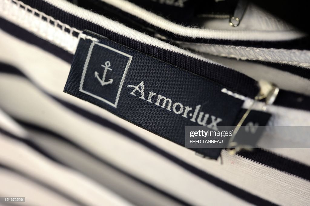 A picture taken on October 24, 2012 in Quimper, western France, shows a tag of the Breton style knits French specialist, Armor Lux.