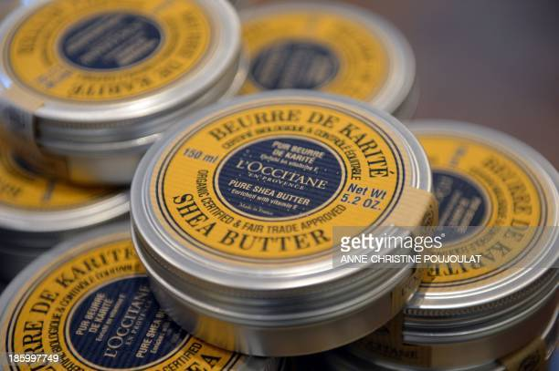 A picture taken on October 24 2013 shows organic and fair trade shea butter tins at French cosmetics company L'Occitane production site in Manosque...