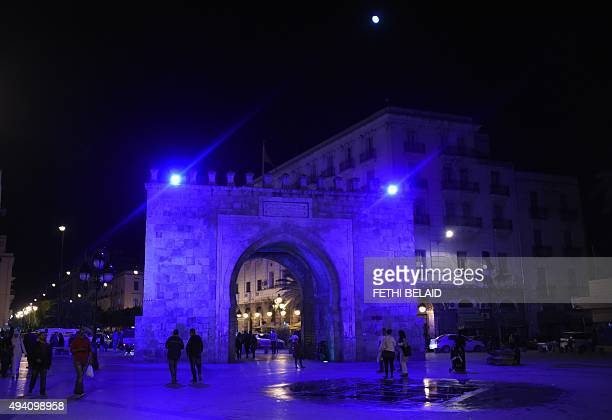 A picture taken on October 24 2015 shows the arch of Bab elBhar one of the gates of the Medina of Tunis illuminated in blue light as part of the...