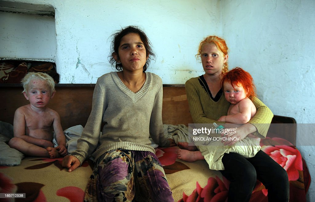 A picture taken on October 24, 2013, shows four of the children of Sasha Ruseva and Atanas Rusev in the Roma district of the central Bulgarian town of Nikolaevo. Bulgarian authorities today questioned a couple thought to be the parents of Maria, a mysterious blonde girl whose discovery in a Greek Roma camp made global headlines. The woman, Sasha Ruseva, was quoted as saying outside the police station in the central town of Gurkovo that desperate poverty had forced her to leave behind a baby in Greece and that Maria looked like she might be hers. 'There is a resemblance, but how should I know if she is mine or not?,' the thin, dark-complexioned Ruseva told reporters, clutching a small, freckled and pale-skinned child of two or three with dyed red hair.