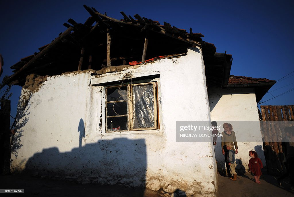 A picture taken on October 24, 2013, shows three of the children of Sasha Ruseva and Atanas Rusev in front of their home in the Roma district of the central Bulgarian town of Nikolaevo. Bulgarian authorities today questioned a couple thought to be the parents of Maria, a mysterious blonde girl whose discovery in a Greek Roma camp made global headlines. The woman, Sasha Ruseva, was quoted as saying outside the police station in the central town of Gurkovo that desperate poverty had forced her to leave behind a baby in Greece and that Maria looked like she might be hers. 'There is a resemblance, but how should I know if she is mine or not?,' the thin, dark-complexioned Ruseva told reporters, clutching a small, freckled and pale-skinned child of two or three with dyed red hair.
