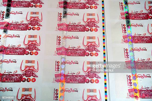 A picture taken on October 26 2009 in Lyon central France shows plates of false printed Algerian Dinar banknotes shown during a press conference...