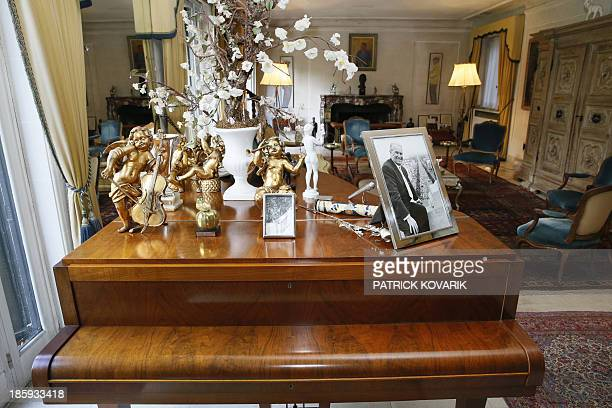 A picture taken on October 26 2013 in MarneslaCoquette outside Paris shows a piano of late French singer legend Maurice Chevalier in a sittingroom of...