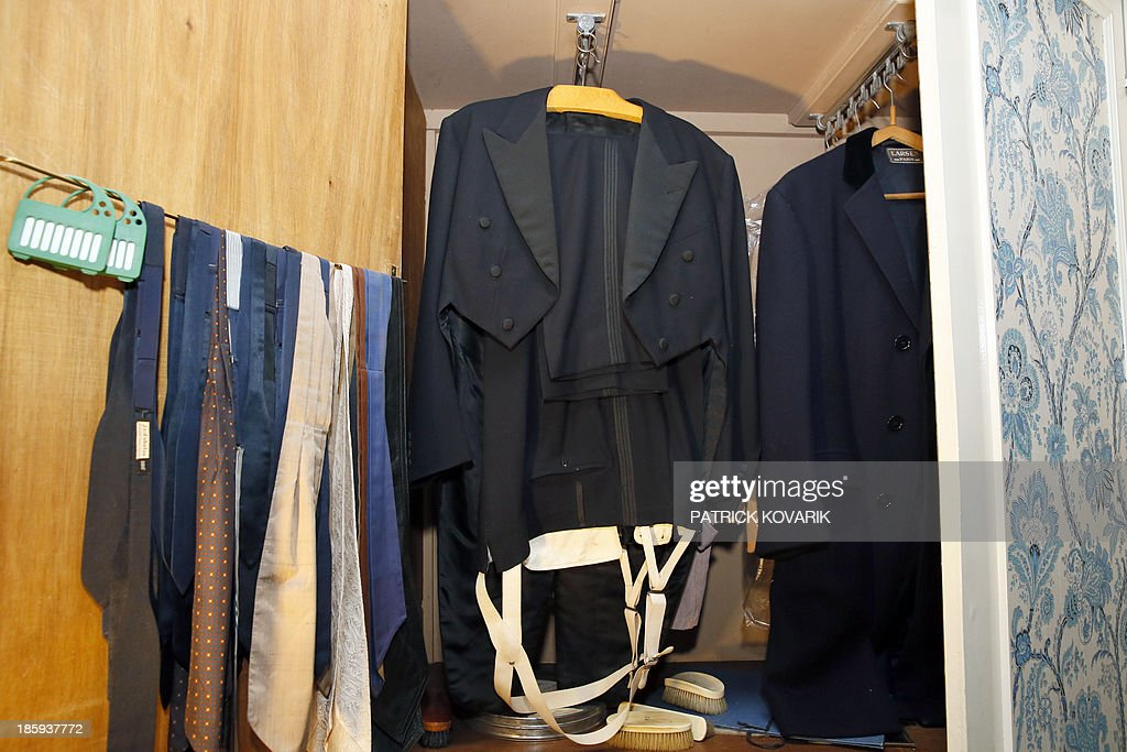 A picture taken on October 26, 2013 in Marnes-la-Coquette, outside Paris, shows a smocking and ties in a dressing-room of late French singer legend Maurice Chevalier in his house, 'La Louque'. 41 years after his death, furniture, souvenirs and home of Maurice Chevalier will be auctionned December 9, 2013, in Paris, following the death of the singer's companion, Odette Meslier, last May.