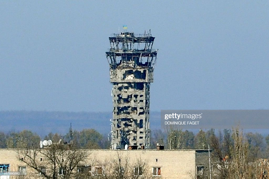 A picture taken on October 26 2014 shows the destroyed control tower of the Sergey Prokofiev international airport in Donetsk eastern Ukraine A...