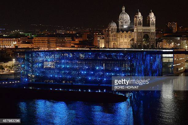 A picture taken on October 26 2014 shows the illuminated Museum of European and Mediterranean Civilisations in Marseille southern France AFP PHOTO /...
