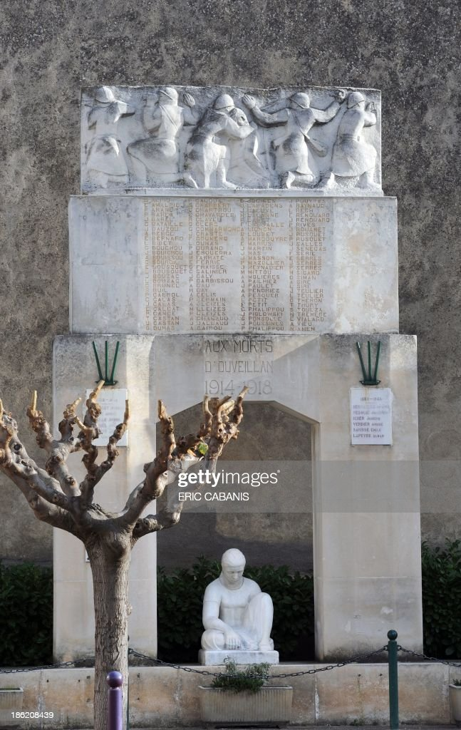 A picture taken on October 27, 2013 shows a marble World War I memorial created in 1927 by French sculptor Rene Iche (1897-1954) in the French southern village of Ouveillan. 2014 will mark the 100th anniversary of the First World War, of which the commemorations will be the first without any direct witnesses of the conflict, as they all passed away. AFP PHOTO ERIC CABANIS