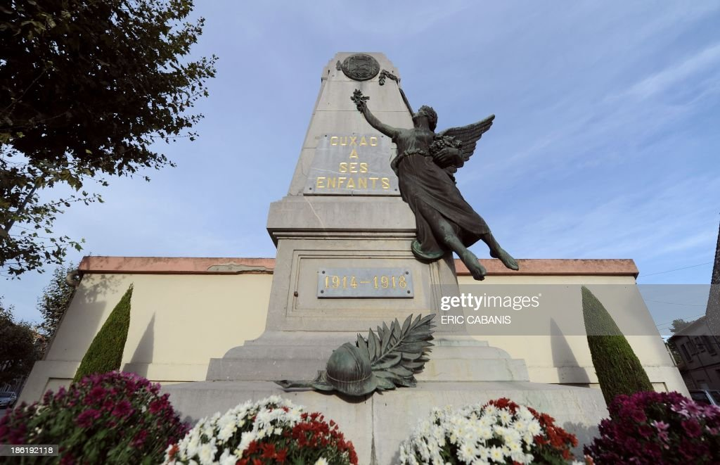 A picture taken on October 27, 2013 shows a World War I memorial in Cuxac-d'Aude, southern France. 2014 will mark the 100th anniversary of the First World War, of which the commemorations will be the first without any direct witnesses of the conflict, as they all passed away. AFP PHOTO ERIC CABANIS