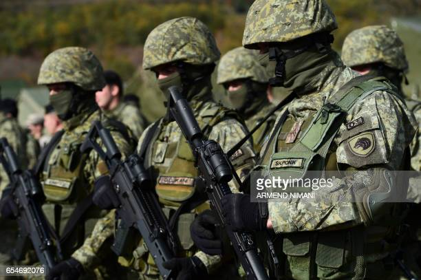 A picture taken on October 27 2016 shows Members of the Kosovo Security Force as they take part in a field exercise in the village of Nashec near the...