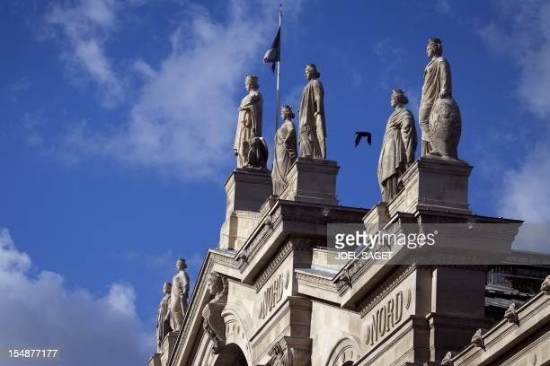 A picture taken on October 28 2012 in Paris shows statues on top of the Gare du Nord railway station AFP PHOTO / JOEL SAGET