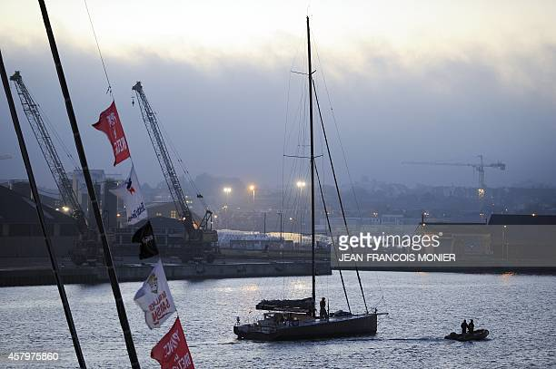 A picture taken on October 28 2014 shows the Imoca class boat of French skipper Marc Guillemot at the harbour in Saint Malo western France few days...