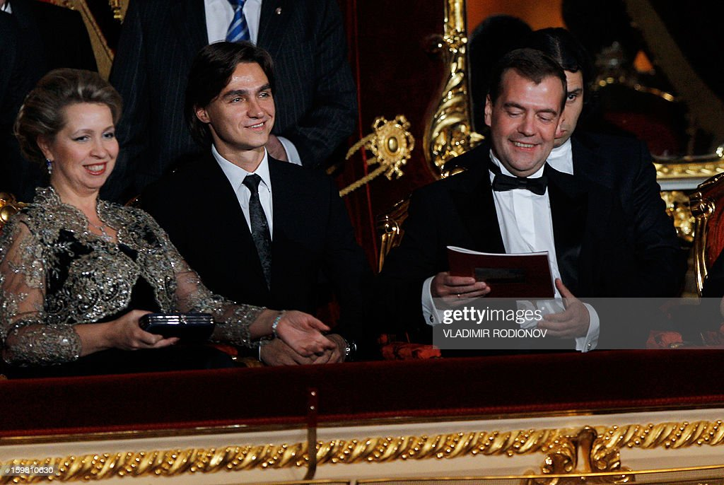 A picture taken on October 28, 2011, shows the Bolshoi ballet's artistic director, Sergei Filin (C), sitting together with then Russia's President Dmitry Medvedev and his wife, Svetlana, as they attend a gala opening of the Bolshoi Theatre in Moscow. Forty-two-year old Filin, an acclaimed former dancer appointed artistic director in 2011, suffered third-degree burns to his face, head and eyes last week when a masked man cornered him near his house in central Moscow and threw acid in his face. The vicious attack may cost Sergei Filin his eyesight, Moscow police said yesterday.