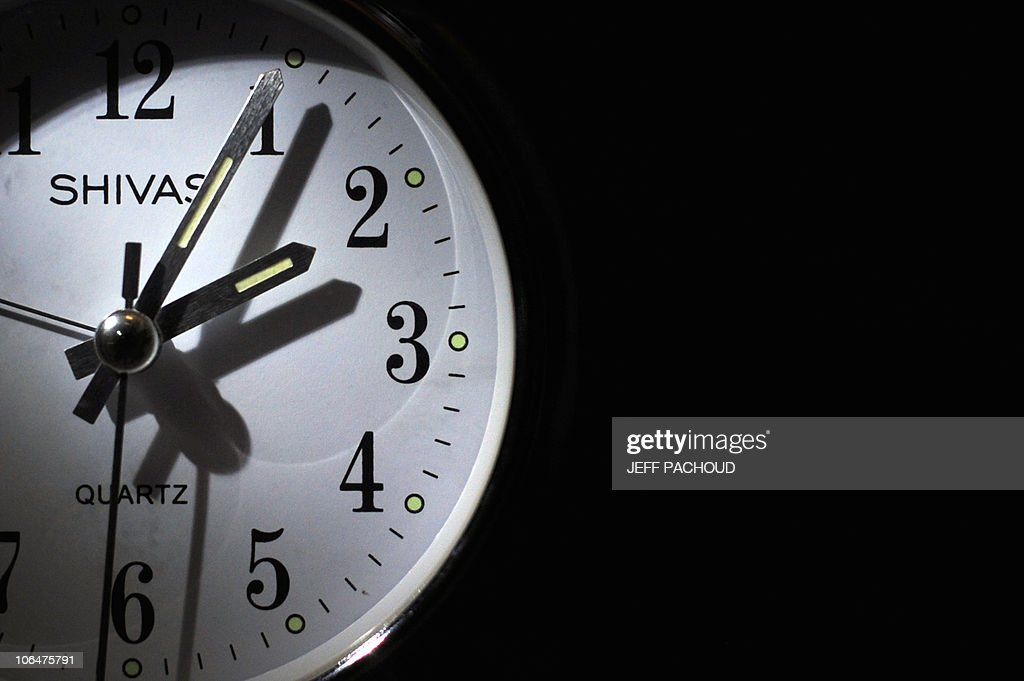 Picture taken on October 29, 2010 in Paris of an alarm clock, as Europe moved to winter time at 0100 GMT on October 31, when clocks move back one hour. Clocks change in North America on November 7. AFP PHOTO / JEFF PACHOUD