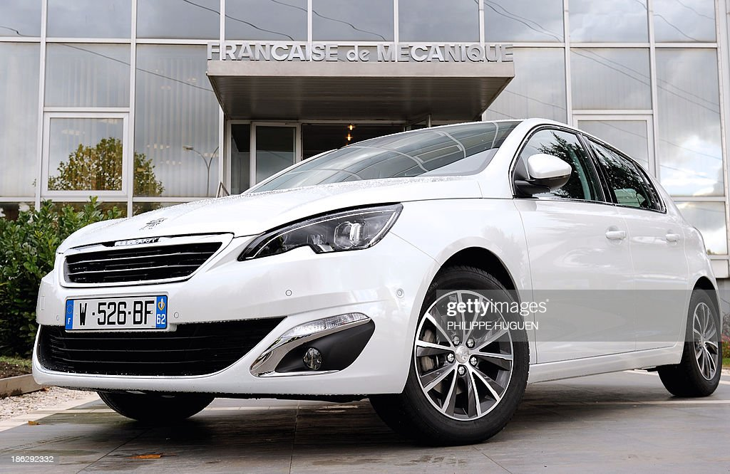 A picture taken on October 29, 2013 shows a new Peugeot 308 equipped with French carmaker PSA Peugeot Citroen's new engine, the three-cylinder EB Turbo 'Pure Tech', on display during the inauguration of an assembly line producing PSA's engine at the Francaise de Mecanique plant in Douvrin, northern France.
