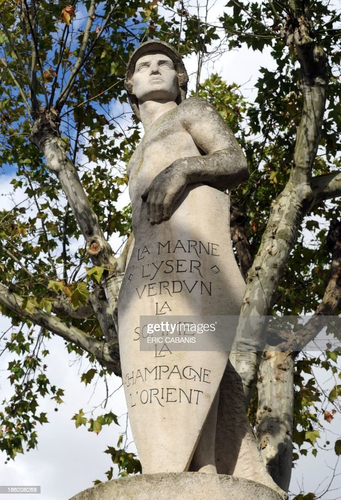 A picture taken on October 29, 2013 shows a statue by French sculptor Auguste Guenot (1882-1966) representing a naked 'Poilu', a French World War I soldier, inspired by Michelangelo's statue of David, at a WWI memorial in the French southern village of Mas-Grenier. 2014 will mark the 100th anniversary of the First World War, of which the commemorations will be the first without any direct witnesses of the conflict, as they all passed away.
