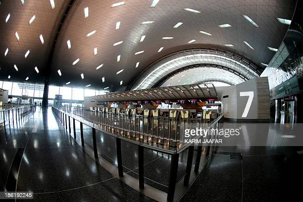A picture taken on October 29 2013 shows the inside of a terminal of Hamad International Airport in Doha AFP PHOTO / ALWATAN DOHA / KARIM JAAFAR ==...