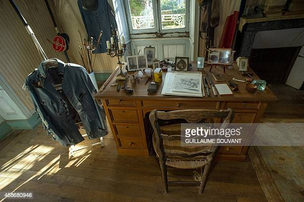 A picture taken on October 29 2014 in Belabre central France shows the uniform and desk of French Word War I second lieutenant Hubert Rochereau in...