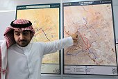 A picture taken on October 29 2014 shows Saudi Abdullah Allohaidan assistant of the director of the Riyadh Metro pointing to the Metro project map...