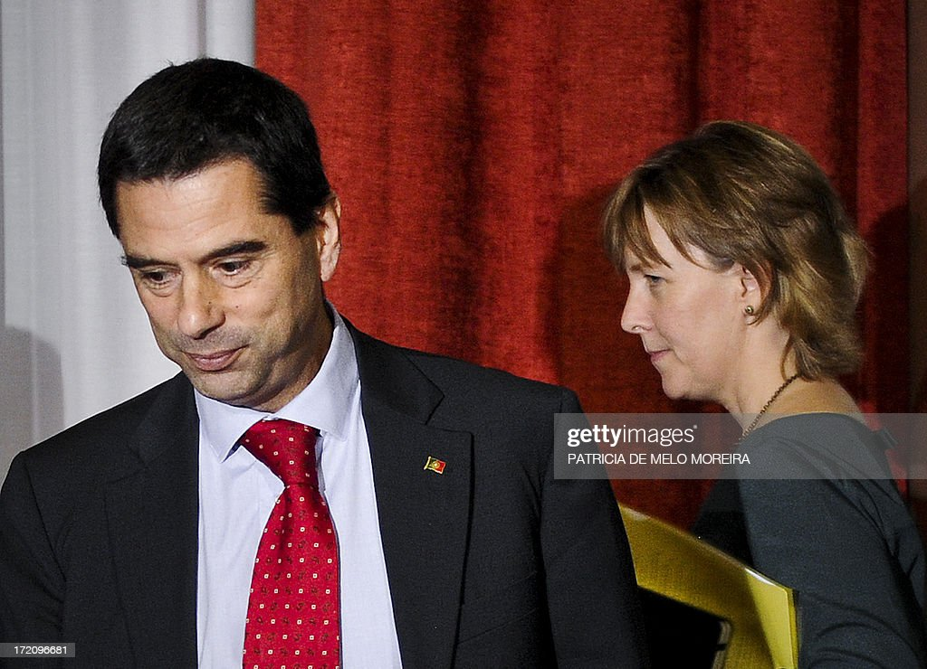 A picture taken on October 3 2012 shows Portuguese Finance Minister Vitor Gaspar and Treasury Secretary Maria Luis Albuquerque arriving for a press...