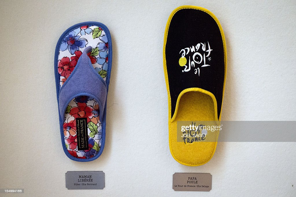 A picture taken on October 30, 2012 shows a shoe entitled 'Maman liberee' ('Mommy is freed') by Pifer / Ferrand company (L) and a Tour de France by-product shoe entitled 'Papa Poule' ('Sugar Daddy') by Delage company, displayed during the exhibition 'La chaussure, une passion française ' ('Shoes, a French passion') at the Atelier Richelieu in Paris. This exhibition, running until November 11, 2012 and organized by the French Shoe Federation (FFC) will focus on French shoe creation and innovation over the last 150 years, and promote the 'French Signature' label.