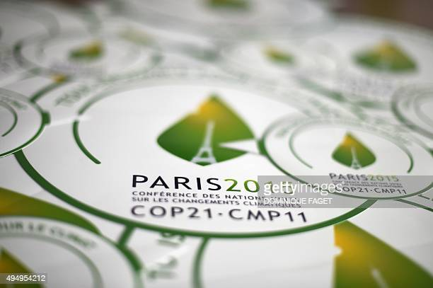 A picture taken on October 30 2015 shows stickers of the COP21 in Paris ahead of the Climate Change Conference 2015 The COP21 organized by the French...