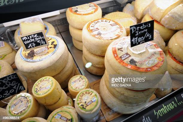 A picture taken on October 30 2015 shows various kind of cheese of the Dairy Cooperative in the Basque Country on display at a sales counter in...