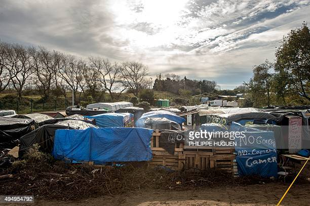 A picture taken on October 30 shows a general view of tents and makeshift shelters at the 'Jungle' migrant camp in Calais Some 6000 migrants are...