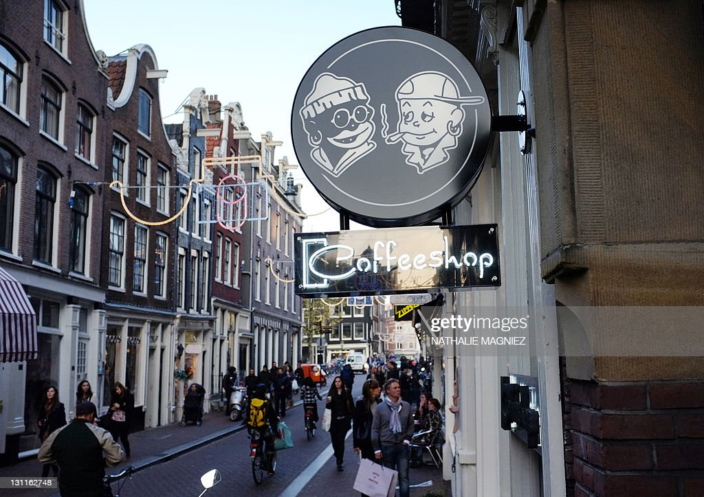 A picture taken on October 31, 2011 in center Amsterdam, shows the neon sign of a coffee shop. Incensed by the 'nuisance' caused by millions of people crossing its borders each year to visit one of 670 licensed coffee shops, the Netherlands plans to turn these cannabis-vending cafes into private clubs for card-carrying members -- Dutch residents only. The consumption and possession of small amounts of cannabis have been decriminalised since 1976 in the Netherlands.