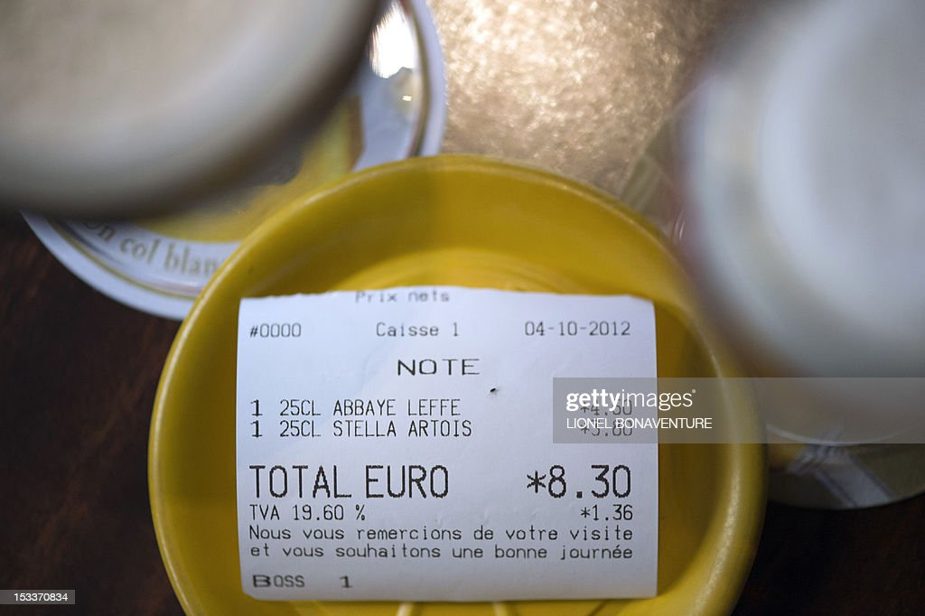 A picture taken on October 4, 2012 in a cafe in Paris shows a bill with the 19.60 percent VAT rate on a table beside glasses of beer. French bar and cafe keepers either feel resignation or anger after the French government announced on October 1 that the level of taxation of beer will increase in France, which is expected to generate 480 millions of euros to French public welfare system (Securite sociale).