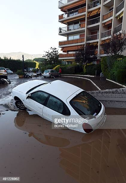 A picture taken on October 4 2015 shows a damaged car during floods in MandelieulaNapoule southeastern France Violent storms and flooding along the...