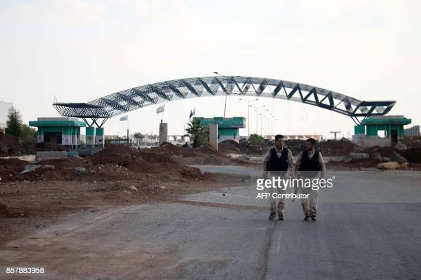 A picture taken on October 5 shows rebel forces patrolling the Syrian side of the Nasib border crossing / AFP PHOTO / Mohamad ABAZEED