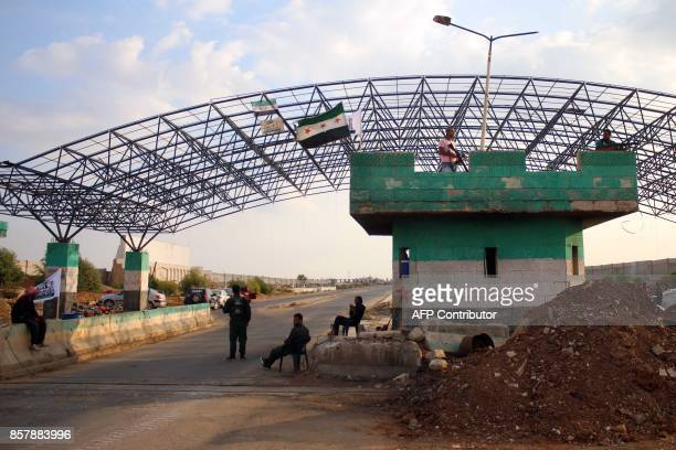A picture taken on October 5 shows rebel forces standing guard on the Syrian side of the Nasib border crossing / AFP PHOTO / Mohamad ABAZEED