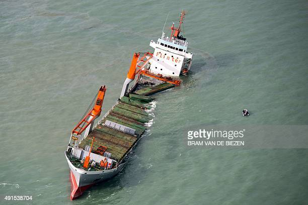 A picture taken on October 6 2015 show Dutch frighter Flinterstar sinking after colliding with Marshall Islandflagged tanker AlOraiq which also...