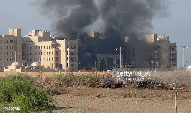 A picture taken on October 6 2015 shows smoke billowing from the AlQasr hotel in Aden's western suburbs after it was hit by a rocket attack Yemen's...