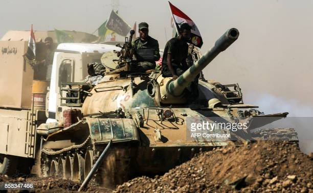 A picture taken on October 6 2017 shows a tank belonging to the Furqat alAbbas Brigade of the Hashed alShaabi paramilitaries advancing towards...