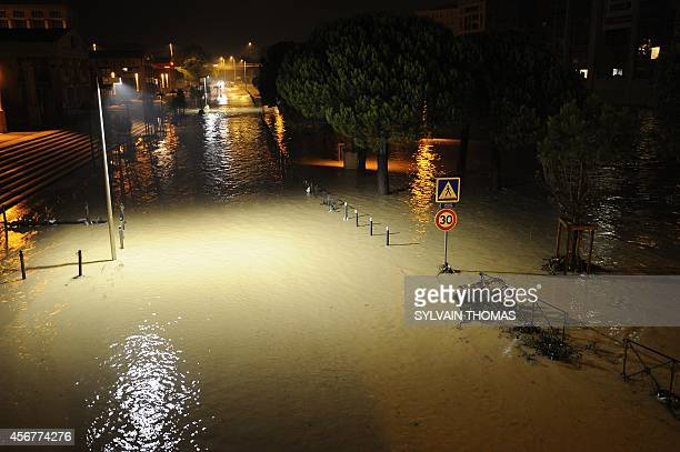 A picture taken on October 7 2014 shows a flooded street near the banks of the Lez river in the southern French city of Montpellier in the department...