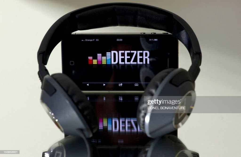 A picture taken on October 9, 2012 in Paris shows headphones beside a smartphone, which is connected to French music streaming website Deezer. Len Blavatnik's Russian-US holding company Access Industries, which already owns Warner Music Group, has made a $130 million investment in French music streaming and subscription service Deezer, according to a press statement of the holding released on October 10, 2012.