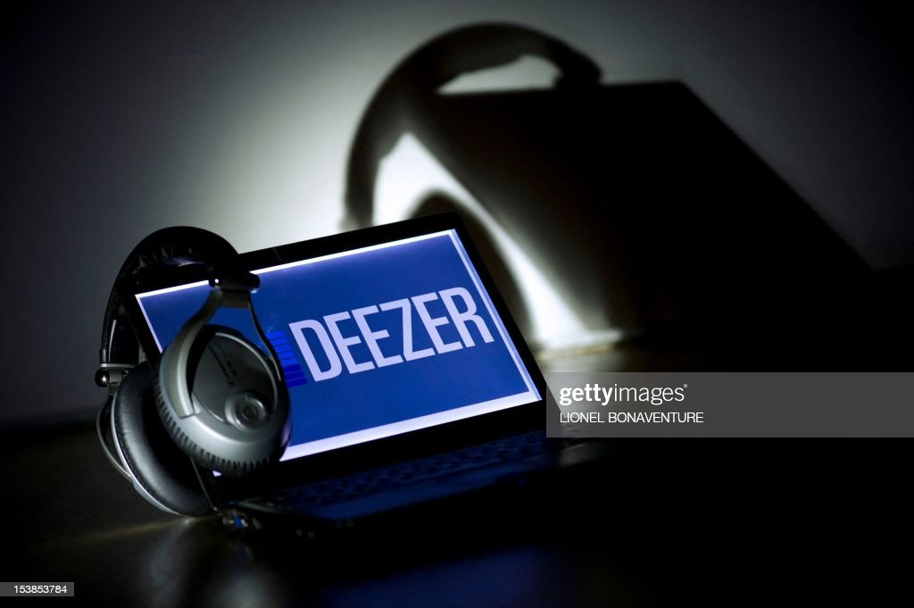 A picture taken on October 9, 2012 in Paris shows headphones hanging on a laptop computer displaying the logo of French music streaming website Deezer.