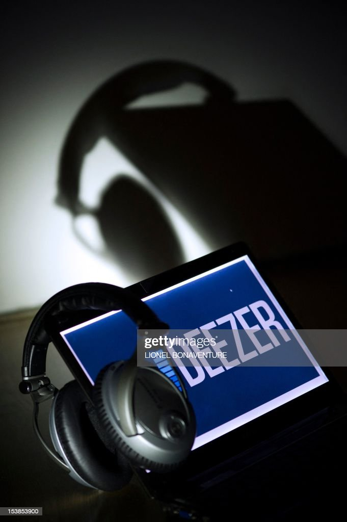 A picture taken on October 9, 2012 in Paris shows headphones hanging on a laptop computer displaying the logo of French music streaming website Deezer. Len Blavatnik's Russian-US holding company Access Industries, which already owns Warner Music Group, has made a $130 million investment in French music streaming and subscription service Deezer, according to a press statement of the holding released on October 10, 2012.