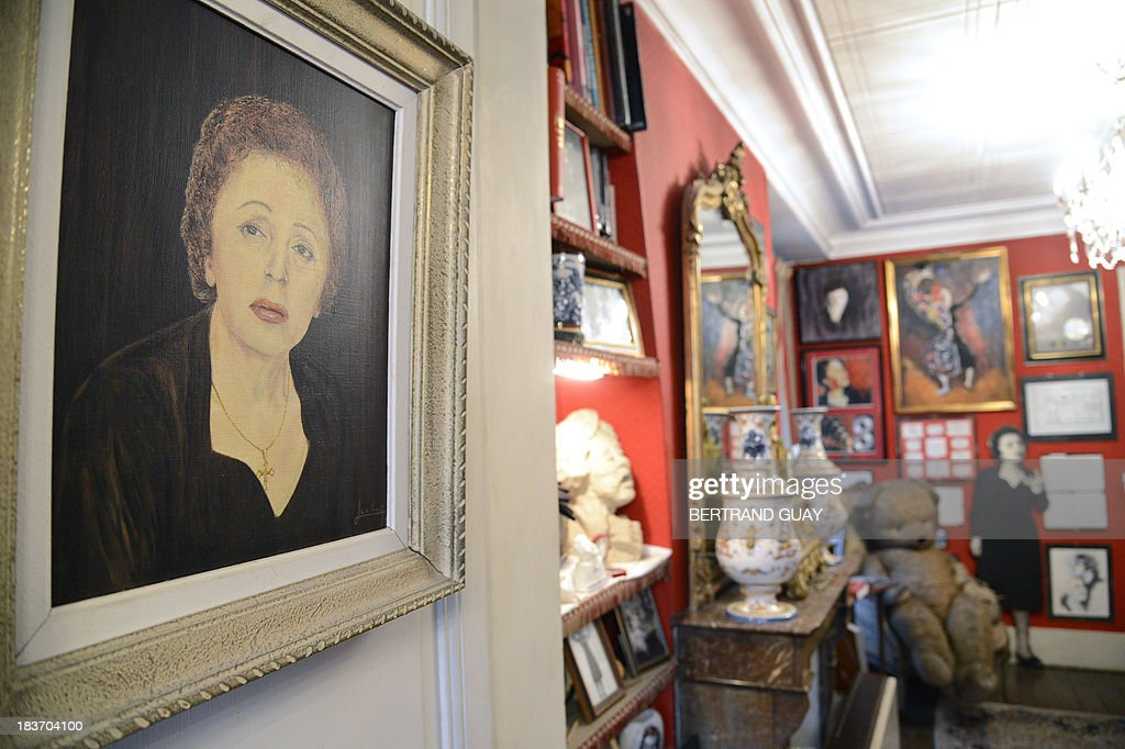 A picture taken on October 9, 2013 shows a painting representing late French singer Edith Piaf displayed in her apartment now turned into a museum in Paris, on the eve of commemorating the 50th anniversary of her death. France's greatest global star Edith Piaf died fifty years ago on October 10, 1963.