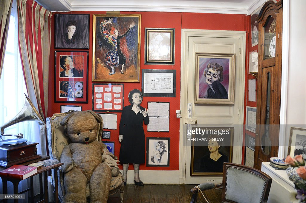 A picture taken on October 9, 2013 shows a picture and paintings representing late French singer Edith Piaf displayed in her apartment now turned into a museum in Paris, on the eve of commemorating the 50th anniversary of her death. France's greatest global star Edith Piaf died fifty years ago on October 10, 1963.