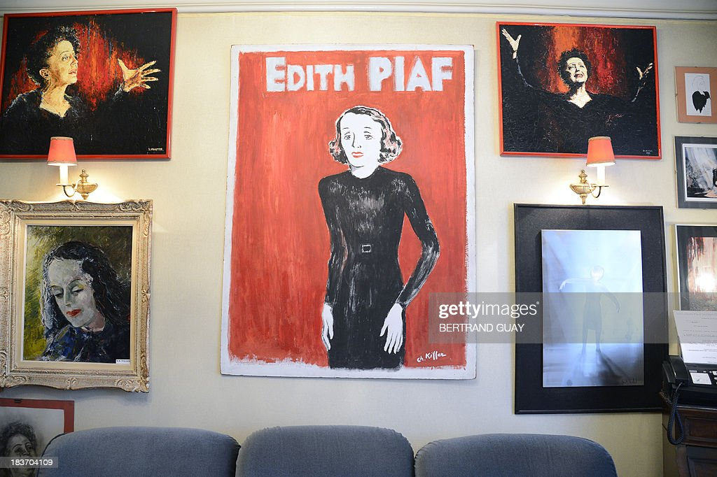A picture taken on October 9, 2013 shows paintings representing late French singer Edith Piaf displayed in her apartment now turned into a museum in Paris, on the eve of commemorating the 50th anniversary of her death. France's greatest global star Edith Piaf died fifty years ago on October 10, 1963.