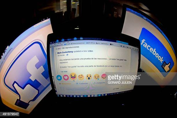 A picture taken on October 9 2015 in Madrid shows a computer screen displaying the Facebook webpage with the new 'Reactions' options as an extension...